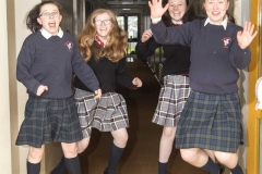 POST PRIMARY STUDENTS JUMPING FOR JOY