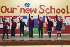 PRIMARY CHOIR WITH NEW SCHOOL BANNER